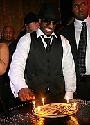 DJ Clue cutting the cake at his b-day