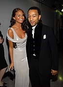 John Legend and Christine Teigen backstage at the 50th Annual Grammys