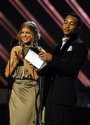Fergie and John Legend present an award at the 50th Annual Grammys