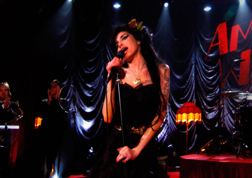 Amy Winehouse performs (via satellite) at the 50th Annual Grammys