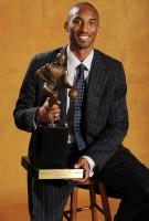 Kobe Bryant Holds His MVP Trophy