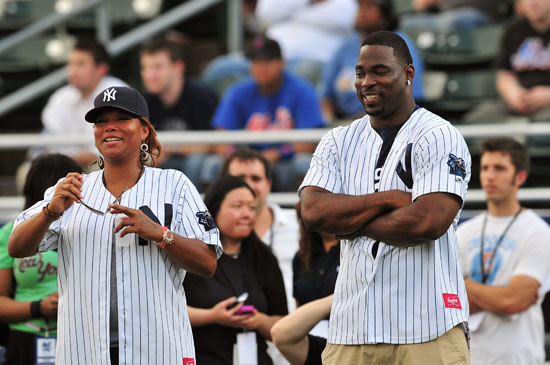 Queen Latifah & Justin Tuck of the New York Giants // 2009 Atlantic League All-Star Game and the Hot 97 vs. KISS-FM Celebrity Softball Showdown