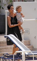 Halle Berry and her daughter Nahla poolside in Miami (July 7th 2009)