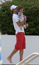 Gabriel Aubry and his daughter Nahla poolside in Miami (July 7th 2009)