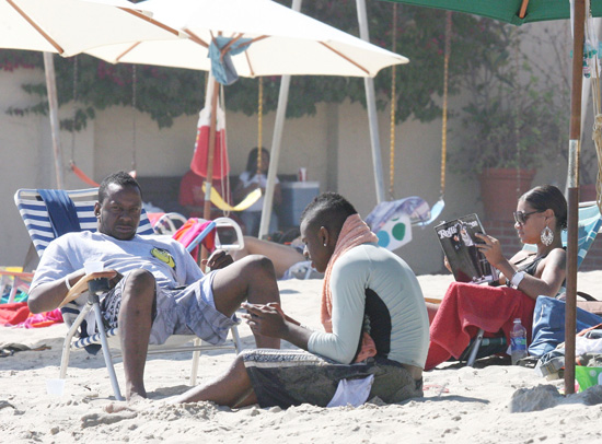 Bobby Brown and Alicia Etheridge on Malibu Beach (July 11th 2009)