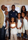 Usher with Allen Rossum of the San Francisco 49ers and his family // Closing Ceremony for Usher's Camp New Look in Atlanta