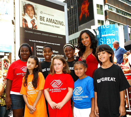 """Ashanti and kids from the Boys & Girls Club // Unveiling of Ashanti's """"Be Amazing"""" Billboard in Times Square, New York City"""
