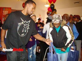 """Daniel """"Boobie"""" Gibson and Keyshia Cole giving away turkeys/groceries at Bethany Baptist Church in Cleveland"""