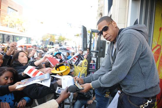 Jay-Z signing autographs for fans outside MuchMusic HQ in Toronto, Canada
