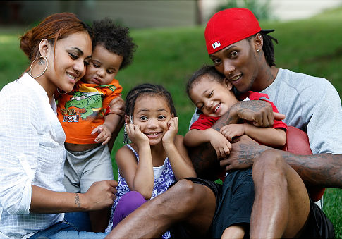 Chris Henry (of the Cincinnati Bengals) and his family: his fiancee Loleini Tonga and their kids DeMarcus, Seini and Chris Jr.