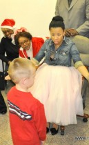 Keyshia Cole delivers Christmas gifts to foster children at ActsFullGospel Church in East Oakland, CA