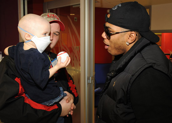 Nelly visits sick children and delivers Christmas gifts at the Aflac Children's Cancer Center of Atlanta