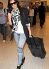 Kim Kardashian arrives at Miami International Airport – January 14th 2010