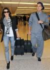 Kim and Robert Kardashian arrive at Miami International Airport – January 14th 2010