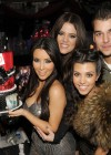 Kim Kardashian with her sisters Khloe & Kourtney, and their younger brother Rob