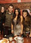 Kim Kardashian with her sisters (Khloe & Kourtney) and their little bro (Rob)