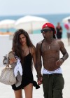 "Lil Wayne and his new ""mystery"" girl at the beach in Miami"