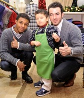 Diggy Simmons and Kevin Jonas at the St. Jude Holiday party