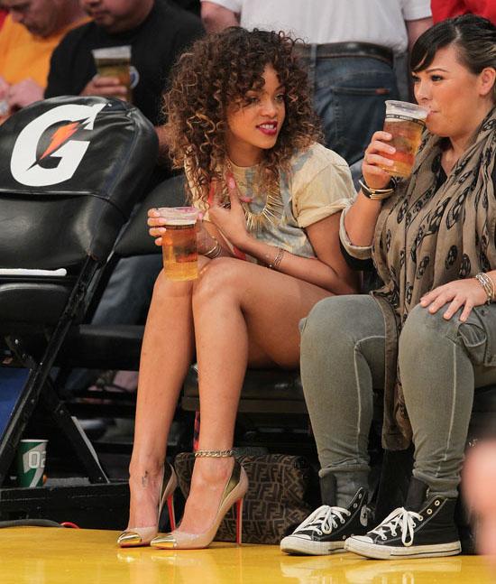 Rihanna Shows Some Leg at Los Angeles Lakers Basketball ...