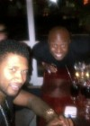Usher and producer Rico Love in Africa