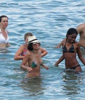 Rocsi in the ocean with Eddie Murphy's 10-year-old daughter Bella (and friends)