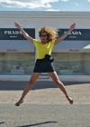 Beyonce poses in front of the Abandoned Prada Marfa store in Texas