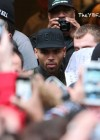 Chris Brown leaves his hotel in Paris wearing a hat from Karrueche's clothing line (Dec 2012)