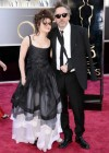 Director Tim Burton and his girlfriend, actress Helena Bonham Carter: Oscars 2013 red carpet