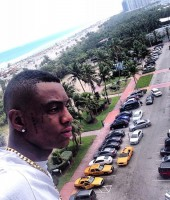 "Soulja Boy in Miami showing off his new ""Rich Gang"" tattoo"
