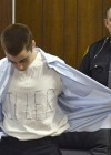 "T.J. Lane wears ""KILLER"" t-shirt in court, tells victims' families: ""FUCK YOU"""
