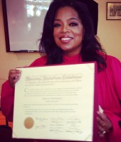 "Oprah Winfrey holding her honory ""Doctor of Law"" degree from Harvard University"