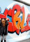 Beyonce poses in front of grafitti-covered Berlin Wall