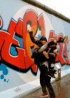 Beyonce and Jay-Z pose in front of grafitti-covered Berlin Wall