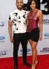 Miguel and his girlfriend Nazanin Mandi on the red carpet of the 2013 BET Awards