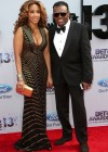 Ronald Isley with his wife Kandy Johnson on the red carpet of the 2013 BET Awards