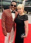 Charlie Wilson and his wife Mahin Tat on the red carpet of the 2013 BET Awards