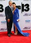 Meagan Good and her husband DeVon Franklin on the red carpet of the 2013 BET Awards