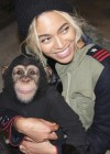 Beyoncé holding a monkey at Blue Ivy's 2nd Birthday Party