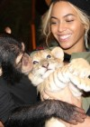 Beyoncé holding a monkey and a tiger at Blue Ivy's 2nd Birthday Party