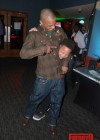 T.I. and his son Domani Harris at Messiah's 14th birthday bowling party