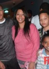 T.I.'s sons Messiah & Domani Harris with their mom LaShon at Messiah's 14th birthday bowling party