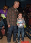 T.I. and his son King Harris at Messiah's 14th birthday bowling party