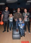 T.I. with all of his sons (L to R: Messiah, King, Major and Domani) at Messiah's 14th birthday bowling party
