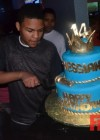 T.I.'s son Messiah Harris cuts his cake at his 14th birthday bowling party