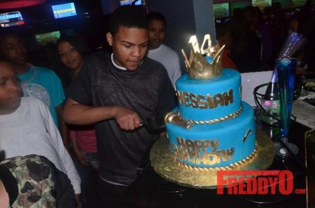 tis son messiah harris cuts his cake at his 14th