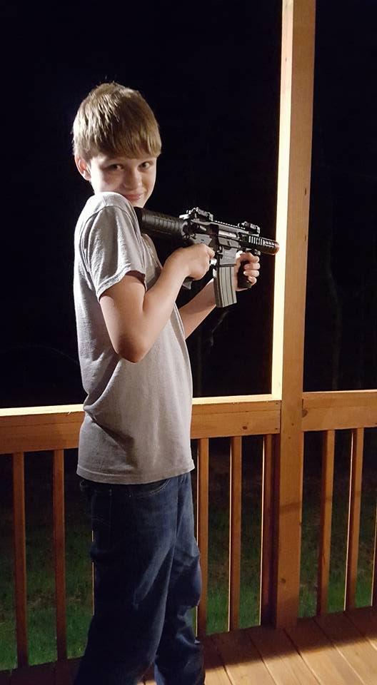 An unconfirmed photo of Jesse Osborne holding an assault rifle.