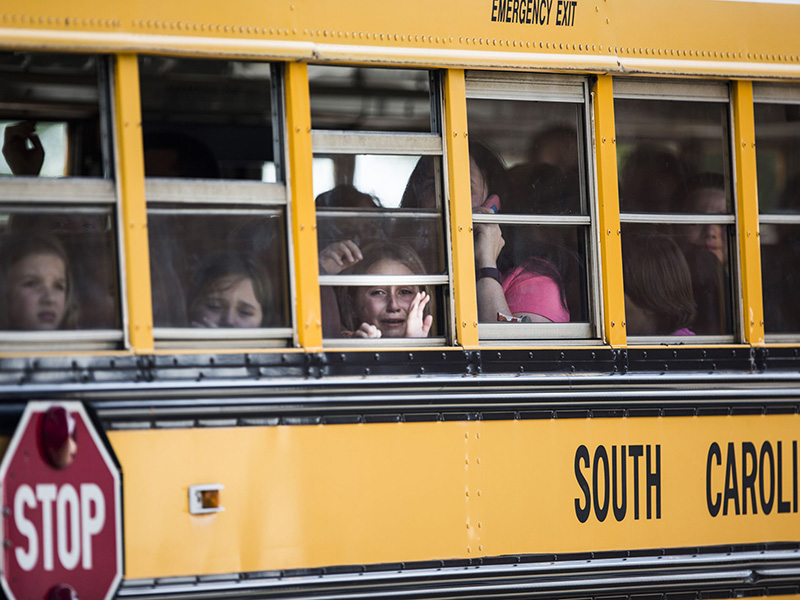 Townville elementary students pictured on a bus as they were transported to a nearby church to be picked up by their parents after the shooting.