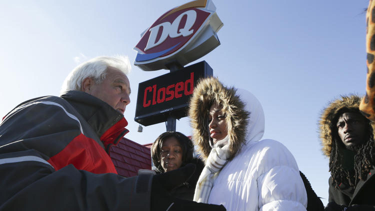 Zion mayor Al Hill, left, talks with Deianeira in front of the Dairy Queen on Jan. 7, 2017